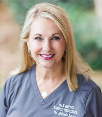 A headshot of our dentist in Hattiesburg, MS while she smiles