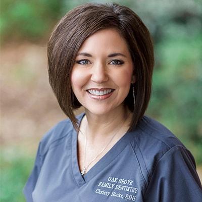 Our dental hygienist Christy wearing her dental uniform