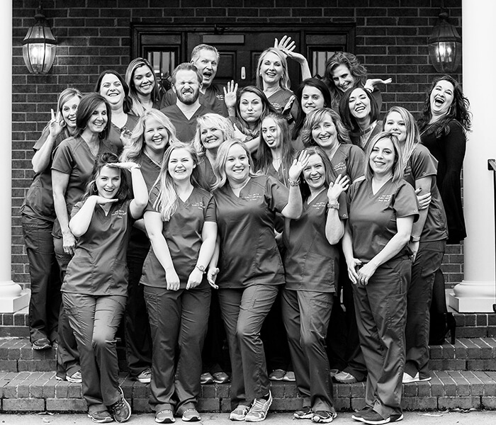 The Oak Grove Family Dentistry team standing in a group smiling and waving